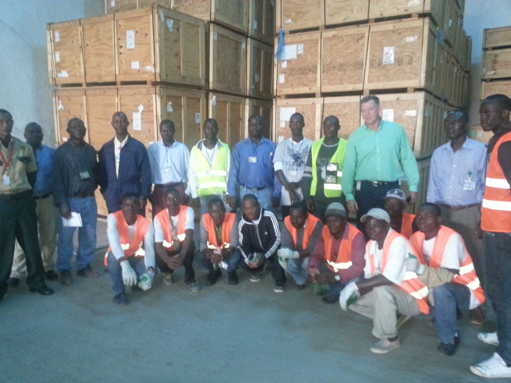 a-fitzgibbon-w-warehouse-crew-in-liberia